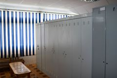 Room, locker room for workers with individual lockers for changing clothes in an industrial plant stock photos