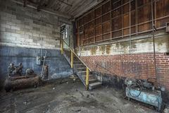 Room with machines in an abandoned factory. Room with random machines in an abandoned factory and brick walls Stock Images