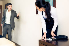 Room Maid Looking Through Hotel Guest`s Wallet Royalty Free Stock Images