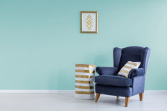 Room with mint wall. And blue armchair stock images
