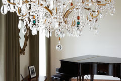 Room In Modern House With Chandelier And Grand Piano Royalty Free Stock Photos