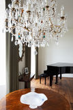 Room In Modern House With Chandelier And Grand Piano Royalty Free Stock Images