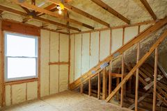 A room at newly constructed home is sprayed with liquid insulating foam stock photo