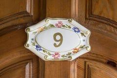 Room 9. Number on wooden door Royalty Free Stock Photo