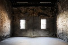 In Room old cement dry and the drak light with window. Brick, panorama, wide, concrete, texture, wall, background, cement, surface, stone, gray, grunge, floor royalty free stock photos