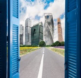 Room with open door to city Stock Images