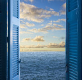 Room with open door  to seascape Stock Photos