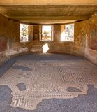 Room with ornamental roman historic mosaic floor in Merida. Merida, Spain - Oct 28, 2017: Room with ornamental roman historic mosaic floor in Merida, Spain on stock photo