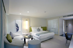 Room. Panoramic view of nice stylish modern bedroom. Images on the wall were changed Stock Images