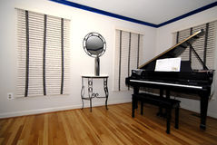Room with Piano. This is part of a room with wood flooring and a piano Stock Photos
