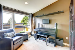Room with piano and guitar Stock Images