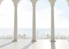 Room with pillars overlooking city and ocean Royalty Free Stock Image