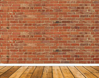 Room with red brick wall and wooden floor Royalty Free Stock Image