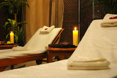 Room for relaxation. Interior of room for relaxation - beds, towels, candles Stock Photography
