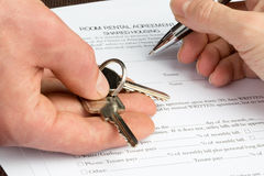 Room Rental agreement document with keys and pen Stock Images