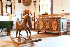 Room with rocking horse Stock Photography