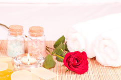 In room romantic spa concept with bath salts. In room romantic spa concept with red rose Stock Image