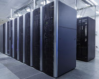 Room with rows of server hardware in the data center. Room with rows of server hardware in data center Royalty Free Stock Photos