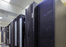 Room with rows of server hardware in data center Royalty Free Stock Images