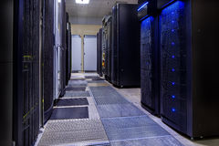 Room with rows of server hardware in data center. Room with rows of server hardware in the data center Stock Image
