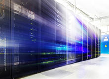 Room with rows of server hardware in the data center Stock Image
