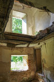 In the room of a ruined house. Wall, door, ceiling in the room of a ruined house stock photography