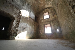 Room of the ruins of an ancient fortess used by soldiers during. Large room of the ruins of an ancient fortess used by soldiers during the First World War near stock photos