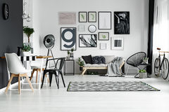 Room in scandinavian style. Spacious living room with dining space designed in scandinavian style Stock Photo