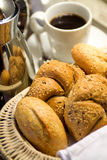 Room Service. A breakfast tray with fresh bread and the morning coffee Stock Photos