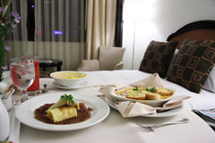 Room service. Food presentation with hotel bed in background Stock Photography