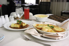 Room service. Food presentation with hotel bed in background Stock Photos