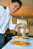 Room service. Waiter showing the food royalty free stock photos