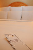 Room Service. Hotel Room Service tag on bed stock photography