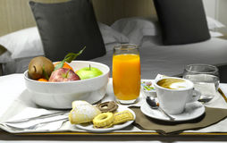 Room Service Breakfast. Breakfast in the room: cappuccino with biscuits and orange juice and fruits stock photo