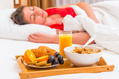 In the Room service breakfast and a sleeping woman Royalty Free Stock Photography