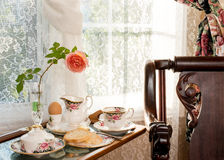Room service - Breakfast in a tray by the window. Stock Photo