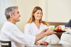 Room service bringing breakfast in bed for couple Royalty Free Stock Photo