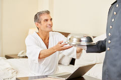 Room service bringing food to hotel room Stock Photography