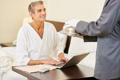 Room service bringing food to hotel room Stock Photo