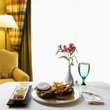 Room service with burger. Stock Photo