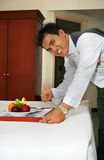 Room service deliver fruit with thumb up. And smile stock photo
