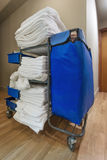 Room service: janitorial cart in the hotel. Housekeeping janitorial cart in hotel corridor Royalty Free Stock Images