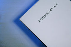 Room service menu. With copy space on light blue background royalty free stock photography