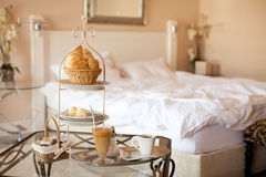 Room service. Nicely served breakfast in bedroom Stock Image