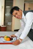 Room service staff. Photograph of room service hotel stock image