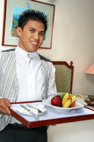 Room service staff bringing fruit. Room service hotel bringing fruit in the room stock images