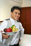 Room service waiter showing fruit. Room service showing fruits in room royalty free stock image