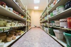 Room with shelves full of ceramic flowerpot Royalty Free Stock Image