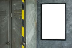 Room with simple white poster. Mockup of inspiring room with simple white poster on dark concrete wall and metal shelf with black and yellow tape royalty free stock photos
