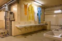 Room with the sink & clothing of workers  Stock Photos